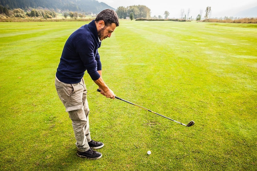 Male golfer with easiest to hit iron