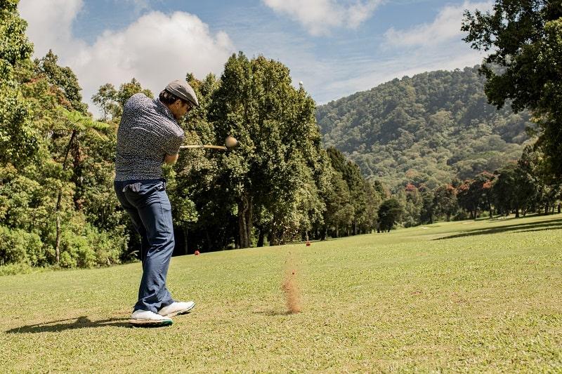 Golfer swings with stiff flex